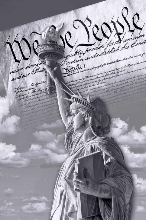 Alt text: Statue of liberty in front of We the People text