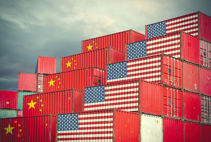 Cargo containers delay Chines and American flags on them