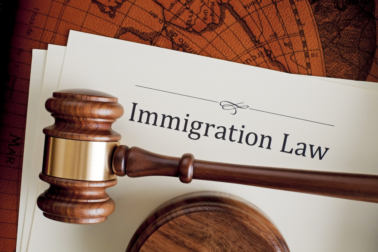 Paper that says Immigration Law with a gavel in front of paper